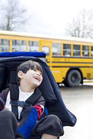 disabled boy and school bus